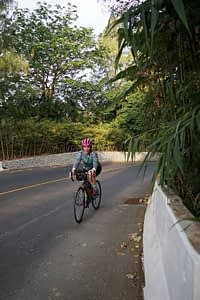 Making early use of my granny gear, cycling up a steep hill on the way to Big Buddha statue, Phuket, Thailand