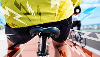 Image of cyclist seated on uncomfortable bike seat, illustrating the problem of poor bike fit and saddle pain
