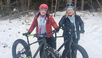 cam and lisa dressed in Terry cycling gear and ready to ride fat bikes for the first time