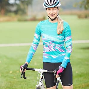 Photo of cyclist model wearing Terry Chill 5 cycling shorts with Soleil Long Sleeve Bike Top in Strata/Green