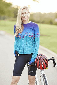 Photo of cycling model wearing NEW Terry Holster Prima Women's Cycling Short, with Soleil Flow Top in Mumbai Rising