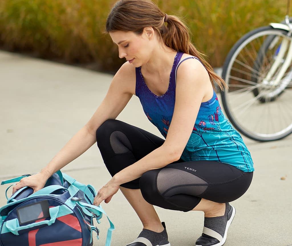Model wearing Terry Studio Capri and Top, our best indoor cycling clothes for demanding riders