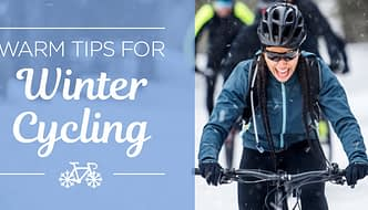 woman riding mountain bike in winter - tips for winter cycling