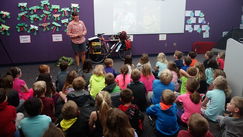 Sara giving a talk to elementary school students about her ride with the butterfly migration