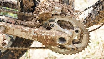Dirty mountain bike covered with mud and dirt – time for some bicycle spring cleaning