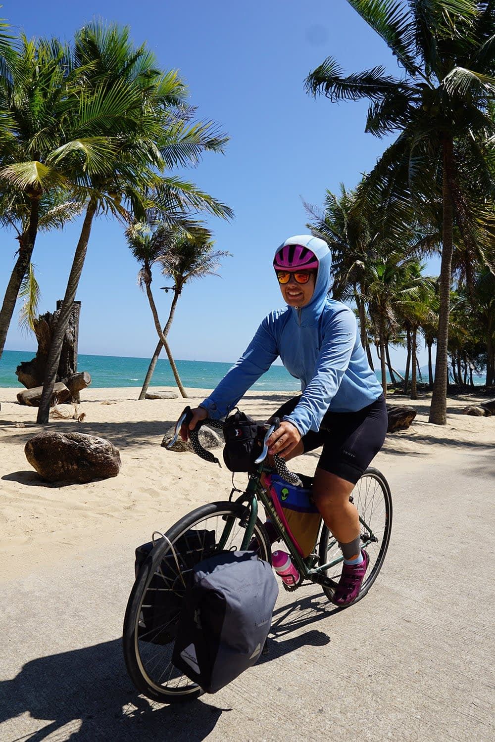 Cycling in the heat of the day, trying to keep the sun off - Ban Krood Beach, Thailand