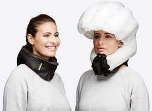 Photo montage of a model wearing the Hovding airbag bike helmet worn around the neck and fully inflated