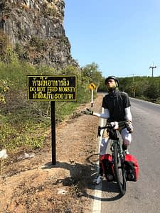 Riding through Khao Sam Roi Yod National Park, Thailand. Paused by a sign reading Do Not Feed The Monkeys.