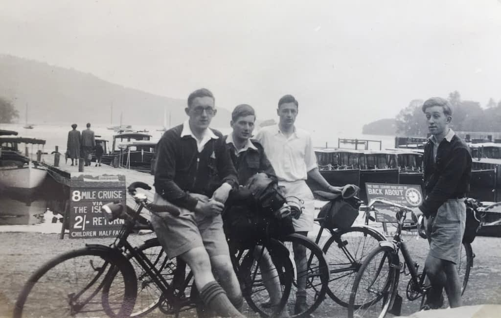 celebrating cycling dads for father's day – Mick Dodgson and friends on a cycling tour in England's Lake District 1940s, waiting for a boat ride.