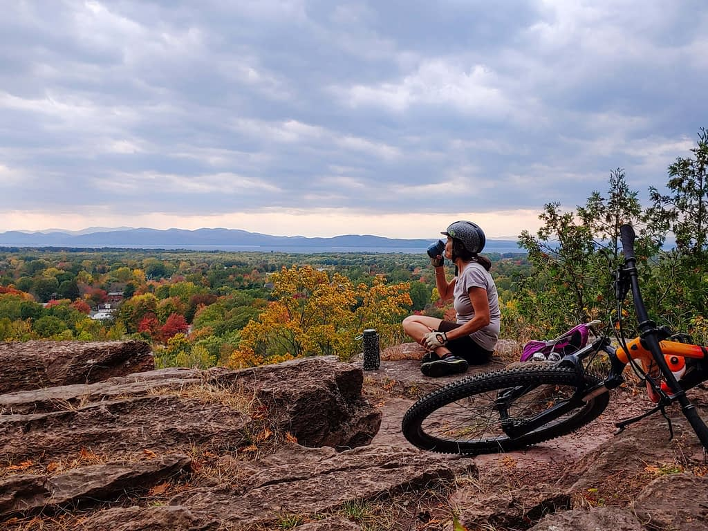 Enjoying a break with a hilltop view on a mountain bike ride in Vermont.