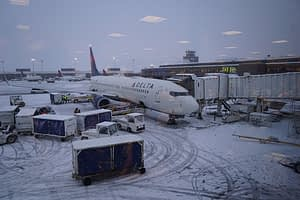 Our plane in the snow, ready to load, and take us far from wintry weather