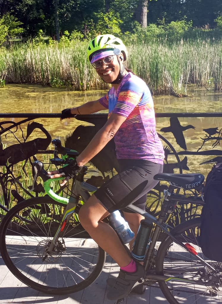 Robin L pausing by a scenic pond during her bike commute in Cleveland OH