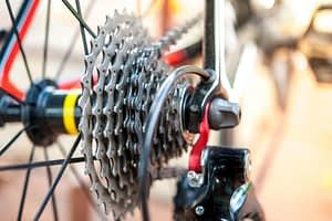 cycling climbing tip about choosing the right equipment - close up of the sprocket cluster of a bicycle equipped for climbing steep hills