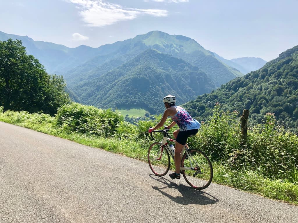 Cycling in the mountains in the south of France, with a view of dramatic mountains in the distance