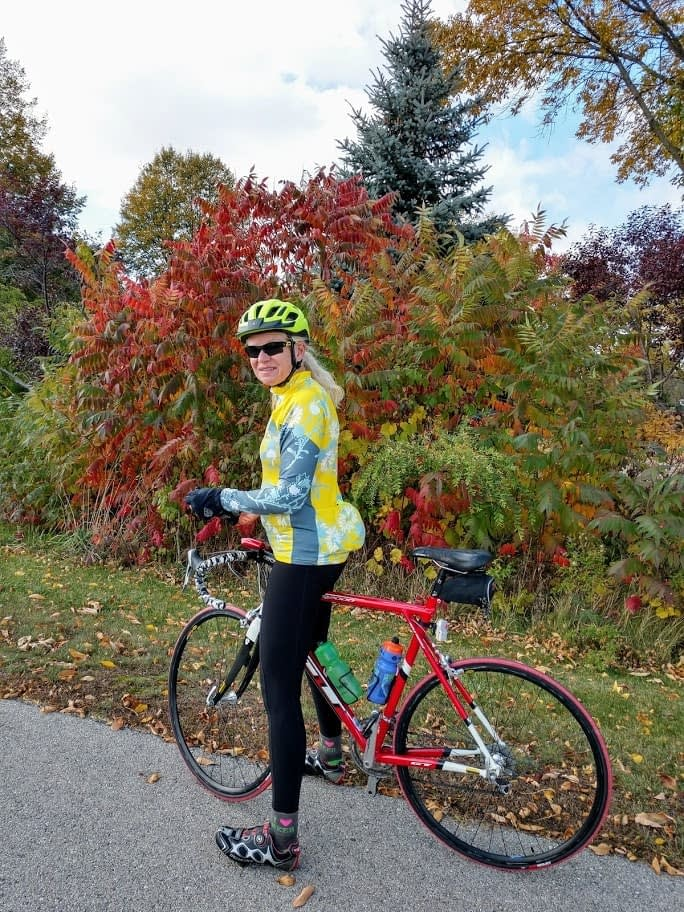 Tracy Flucke pauses during a fall 2020 bike ride