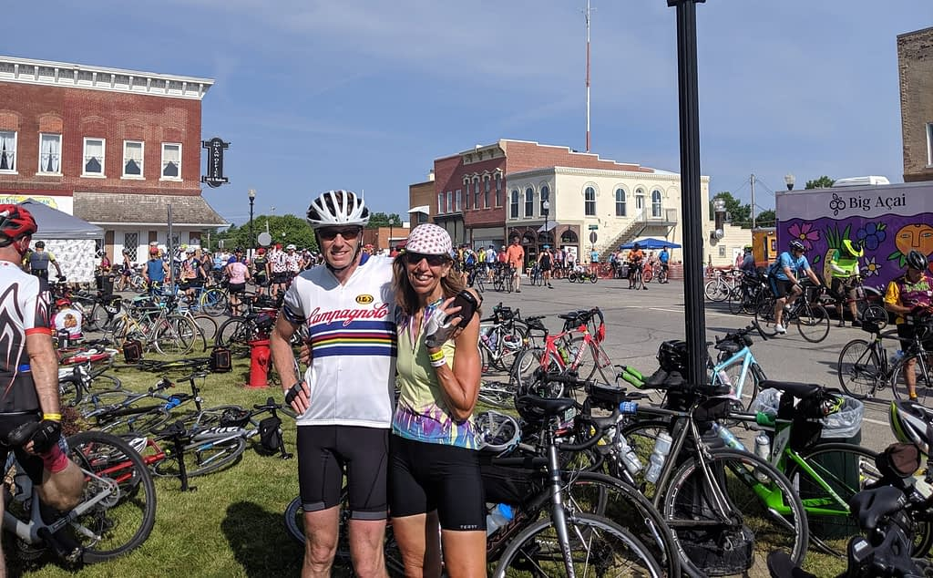 RAGBRAI 2019 - Jeanette S of Terry Bicycles and companion in a bicycle filled street in an Iowa town