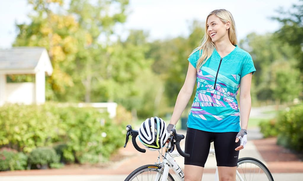Photo of cyclist model wearing Terry cycling clothes including bike shorts designed for long distance rides.