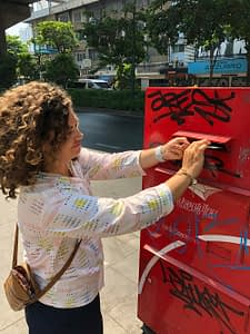 Mailing postcards in a post box, Bangkok, on our cycling tour inThailand