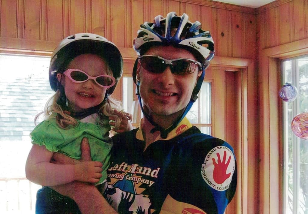 Celebrating cycling dads on father's day – Photo of Phil D. with daughter, ready for a ride in the Burley trailer
