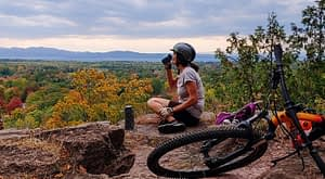 Enjoying a hilltop view on a mountain bike ride in Vermont