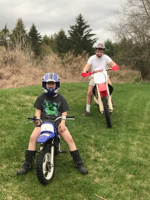 Celebrating cycling dads on father's day – Photo of Joel  with son enjoying powered 2-wheelers
