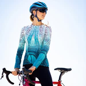 Photo of model wearing Terry Soleil Long sleeve cycling jersey in Stained Glass print, special edition celebrating the tour de france 2019